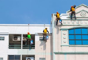 painters-outside-building-painting